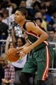 Jan 31, 2014; Orlando, FL, USA; Milwaukee Bucks shooting guard Giannis Antetokounmpo (34) dribbles the ball against the Orlando Magic during the second half at Amway Center. Orlando Magic defeated the Milwaukee Bucks 113-102.  Mandatory Credit: Kim Klement-USA TODAY Sports