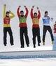 Feb 20, 2014; Krasnaya Polyana, RUSSIA;  Eric Frenzel (red), Bjoern Kircheisen (green), Johannes Rydzek (orange), and Fabian Riessle (blue) win silver in nordic combined team gundersen LH / 4x5 km during the Sochi 2014 Olympic Winter Games at RusSki Gorki Ski Jumping Center. Mandatory Credit: Andrew P. Scott-USA TODAY Sports