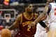 Feb 18, 2014; Philadelphia, PA, USA; Cleveland Cavaliers guard Kyrie Irving (2) is defended by Philadelphia 76ers forward Thaddeus Young (21) during the first quarter at the Wells Fargo Center. The Cavaliers defeated the Sixers 114-85. Mandatory Credit: Howard Smith-USA TODAY Sports