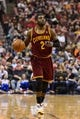 Feb 18, 2014; Philadelphia, PA, USA; Cleveland Cavaliers guard Kyrie Irving (2) brings the ball up court during the first quarter against the Philadelphia 76ers at the Wells Fargo Center. The Cavaliers defeated the Sixers 114-85. Mandatory Credit: Howard Smith-USA TODAY Sports