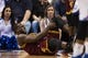 Feb 18, 2014; Philadelphia, PA, USA; Cleveland Cavaliers guard Dion Waiters (3) holds his knee after being injured during the second quarter against the Philadelphia 76ers at the Wells Fargo Center. The Cavaliers defeated the Sixers 114-85. Mandatory Credit: Howard Smith-USA TODAY Sports