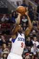 Feb 18, 2014; Philadelphia, PA, USA; Philadelphia 76ers guard James Anderson (9) shoots a jump shot during the third quarter against the Cleveland Cavaliers at the Wells Fargo Center. The Cavaliers defeated the Sixers 114-85. Mandatory Credit: Howard Smith-USA TODAY Sports