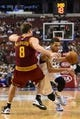 Feb 18, 2014; Philadelphia, PA, USA; Philadelphia 76ers guard Michael Carter-Williams (1) is defended by Cleveland Cavaliers guard Matthew Dellavedova (8) during the fourth quarter at the Wells Fargo Center. The Cavaliers defeated the Sixers 114-85. Mandatory Credit: Howard Smith-USA TODAY Sports