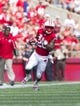 Aug 31, 2013; Madison, WI, USA; Wisconsin Badgers running back James White (20) during the game against the Massachusetts Minutemen at Camp Randall Stadium. Mandatory Credit: Jeff Hanisch-USA TODAY Sports