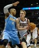 Feb 20, 2014; Milwaukee, WI, USA;  Milwaukee Bucks guard Nate Wolters (6) drives for the basket against Denver Nuggets guard Randy Foye (4) in the 3r quarter at BMO Harris Bradley Center. The Nuggets beat the Bucks 101-90. Mandatory Credit: Benny Sieu-USA TODAY Sports