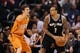 Feb 21, 2014; Phoenix, AZ, USA; San Antonio Spurs guard Shannon Brown (1) is defended by Phoenix Suns guard Goran Dragic (1) in the first half at US Airways Center. Mandatory Credit: Jennifer Stewart-USA TODAY Sports