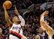 Feb 21, 2014; Portland, OR, USA; Portland Trail Blazers point guard Damian Lillard (0) shoots over Utah Jazz center Enes Kanter (0) during the second quarter at the Moda Center. Mandatory Credit: Craig Mitchelldyer-USA TODAY Sports