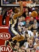 Feb 21, 2014; Portland, OR, USA; Utah Jazz point guard Alec Burks (10) dunks against the Portland Trail Blazers during the second quarter at the Moda Center. Mandatory Credit: Craig Mitchelldyer-USA TODAY Sports