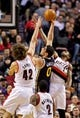 Feb 21, 2014; Portland, OR, USA; Utah Jazz center Enes Kanter (0) shoots over Portland Trail Blazers center Robin Lopez (42 and small forward Dorell Wright (1) during the second quarter at the Moda Center. Mandatory Credit: Craig Mitchelldyer-USA TODAY Sports