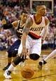 Feb 21, 2014; Portland, OR, USA; Portland Trail Blazers point guard Damian Lillard (0) drives past Utah Jazz point guard Trey Burke (3) during the second quarter at the Moda Center. Mandatory Credit: Craig Mitchelldyer-USA TODAY Sports
