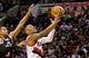 Feb 21, 2014; Portland, OR, USA; Portland Trail Blazers point guard Damian Lillard (0) shoots over Utah Jazz point guard Trey Burke (3) during the second quarter at the Moda Center. Mandatory Credit: Craig Mitchelldyer-USA TODAY Sports