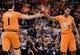 Feb 21, 2014; Phoenix, AZ, USA; Phoenix Suns guard Goran Dragic (1) celebrates with guard Ish Smith (3) against the San Antonio Spurs in the first half at US Airways Center. The Suns won 106-85. Mandatory Credit: Jennifer Stewart-USA TODAY Sports