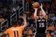 Feb 21, 2014; Phoenix, AZ, USA; San Antonio Spurs forward Matt Bonner (15) puts up a shot over the Phoenix Suns forward Markieff Morris (11) in the second half at US Airways Center. The Suns defeated the Spurs 106-85. Mandatory Credit: Jennifer Stewart-USA TODAY Sports
