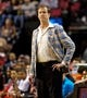 Feb 21, 2014; Portland, OR, USA; Portland Trail Blazers head coach Terry Stotts honors former Blazers coach Jack Ramsey's birthday by wearing a 70's era suit on the sidelines against the Utah Jazz at the Moda Center. Mandatory Credit: Craig Mitchelldyer-USA TODAY Sports