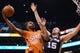 Feb 21, 2014; Phoenix, AZ, USA; Phoenix Suns forward Markieff Morris (11) goes up with the ball against the San Antonio Spurs forward Matt Bonner (15) in the first half at US Airways Center. The Suns defeated the Spurs 106-85. Mandatory Credit: Jennifer Stewart-USA TODAY Sports