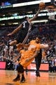 Feb 21, 2014; Phoenix, AZ, USA; San Antonio Spurs guard Shannon Brown (1) lays the ball up over Phoenix Suns forward Markieff Morris (11) in the second half at US Airways Center. The Suns defeated the Spurs 106-85. Mandatory Credit: Jennifer Stewart-USA TODAY Sports