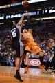Feb 21, 2014; Phoenix, AZ, USA; San Antonio Spurs guard Cory Joseph (5) blocks Phoenix Suns guard Goran Dragic (1) in the first half at US Airways Center. The Suns defeated the Spurs 106-85. Mandatory Credit: Jennifer Stewart-USA TODAY Sports