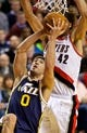 Feb 21, 2014; Portland, OR, USA; Utah Jazz center Enes Kanter (0) shoots over Portland Trail Blazers center Robin Lopez (42) during the fourth quarter at the Moda Center. Mandatory Credit: Craig Mitchelldyer-USA TODAY Sports