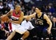 Feb 22, 2014; Washington, DC, USA; Washington Wizards guard Andre Miller (24) is defended by New Orleans Pelicans guard Austin Rivers (25) at Verizon Center. Mandatory Credit: Evan Habeeb-USA TODAY Sports