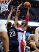 Feb 22, 2014; Washington, DC, USA; Washington Wizards forward Nene (42) dunks the ball over New Orleans Pelicans forward Anthony Davis (23) at Verizon Center. Mandatory Credit: Evan Habeeb-USA TODAY Sports