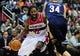 Feb 22, 2014; Washington, DC, USA; Washington Wizards forward Nene (42) is defended by New Orleans Pelicans center Greg Stiemsma (34) at Verizon Center. Mandatory Credit: Evan Habeeb-USA TODAY Sports