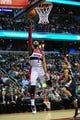 Feb 22, 2014; Washington, DC, USA; Washington Wizards guard John Wall (2) lays the ball up past New Orleans Pelicans guard Brian Roberts (22) at Verizon Center. Mandatory Credit: Evan Habeeb-USA TODAY Sports