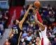 Feb 22, 2014; Washington, DC, USA; Washington Wizards guard Bradley Beal (3) shoots the ball over New Orleans Pelicans forward Anthony Davis (23) at Verizon Center. Mandatory Credit: Evan Habeeb-USA TODAY Sports