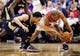 Feb 22, 2014; Washington, DC, USA; Washington Wizards guard Andre Miller (24) fights for a loose ball with New Orleans Pelicans guard Austin Rivers (25) at Verizon Center. Mandatory Credit: Evan Habeeb-USA TODAY Sports