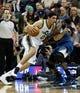 Feb 22, 2014; Salt Lake City, UT, USA; Utah Jazz center Enes Kanter (0) moves past Minnesota Timberwolves center Gorgui Dieng (5) during the second quarter at EnergySolutions Arena. Mandatory Credit: Chris Nicoll-USA TODAY Sports