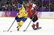 Feb 23, 2014; Sochi, RUSSIA; Sweden forward Daniel Sedin (22) controls the puck against Canada forward Ryan Getzlaf (15) in the men's ice hockey gold medal game during the Sochi 2014 Olympic Winter Games at Bolshoy Ice Dome. Mandatory Credit: Eric Bolte-USA TODAY Sports