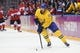 Feb 23, 2014; Sochi, RUSSIA; Sweden forward Daniel Sedin (22) skates with the puck against Canada in the men's ice hockey gold medal game during the Sochi 2014 Olympic Winter Games at Bolshoy Ice Dome. Mandatory Credit: Winslow Townson-USA TODAY Sports