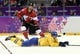Feb 23, 2014; Sochi, RUSSIA; Canada forward Jamie Benn (22) shoots the puck past Sweden forward Daniel Sedin (22) in the men's ice hockey gold medal game during the Sochi 2014 Olympic Winter Games at Bolshoy Ice Dome. Mandatory Credit: Eric Bolte-USA TODAY Sports