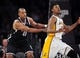 February 23, 2014; Los Angeles, CA, USA; Brooklyn Nets center Jason Collins (46) defends against Los Angeles Lakers small forward Nick Young (0) during the first half at Staples Center. Mandatory Credit: Gary A. Vasquez-USA TODAY Sports