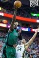 Feb 24, 2014; Salt Lake City, UT, USA; Boston Celtics small forward Jeff Green (8) shoots the ball over Utah Jazz small forward Richard Jefferson (24) during the first half at EnergySolutions Arena. Mandatory Credit: Russ Isabella-USA TODAY Sports
