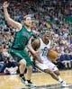 Feb 24, 2014; Salt Lake City, UT, USA; Utah Jazz point guard Alec Burks (10) dribbles the ball around Boston Celtics center Kelly Olynyk (41) during the second half at EnergySolutions Arena. The Jazz won 110-98. Mandatory Credit: Russ Isabella-USA TODAY Sports