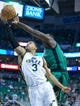 Feb 24, 2014; Salt Lake City, UT, USA; Boston Celtics power forward Brandon Bass (30) blocks the shot by Utah Jazz point guard Trey Burke (3) during the second half at EnergySolutions Arena. The Jazz won 110-98. Mandatory Credit: Russ Isabella-USA TODAY Sports