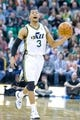 Feb 24, 2014; Salt Lake City, UT, USA; Utah Jazz point guard Trey Burke (3) dribbles the ball during the second half against the Boston Celtics at EnergySolutions Arena. The Jazz won 110-98. Mandatory Credit: Russ Isabella-USA TODAY Sports