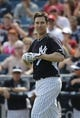 Feb 25, 2014; Tampa, FL, USA; New York Yankees second baseman Kelly Johnson (33) reacts after he struck out during the first inning against the Florida State Seminoles at George M. Steinbrenner Field. Mandatory Credit: Kim Klement-USA TODAY Sports