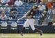 Feb 25, 2014; Tampa, FL, USA; New York Yankees center fielder Brett Gardner (11) singles during the first inning against the Florida State Seminoles at George M. Steinbrenner Field. Mandatory Credit: Kim Klement-USA TODAY Sports