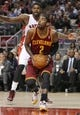 Feb 21, 2014; Toronto, Ontario, CAN; Cleveland Cavaliers guard Kyrie Irving (2) goes to the basket against the Toronto Raptors at Air Canada Centre. The Raptors beat the Cavaliers 98-91. Mandatory Credit: Tom Szczerbowski-USA TODAY Sports