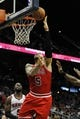 Feb 25, 2014; Atlanta, GA, USA; Chicago Bulls power forward Carlos Boozer (5) shoots the ball against the Atlanta Hawks in the first quarter at Philips Arena. Mandatory Credit: Brett Davis-USA TODAY Sports