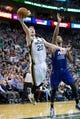 Feb 26, 2014; Salt Lake City, UT, USA; Utah Jazz shooting guard Gordon Hayward (20) goes up for a shot in front of Phoenix Suns power forward Marcus Morris (15) during the second half at EnergySolutions Arena. The Jazz won 109-86. Mandatory Credit: Russ Isabella-USA TODAY Sports