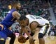 Feb 26, 2014; Salt Lake City, UT, USA; Phoenix Suns power forward Marcus Morris (15) defends against Utah Jazz center Derrick Favors (15) during the second half at EnergySolutions Arena. The Jazz won 109-86. Mandatory Credit: Russ Isabella-USA TODAY Sports