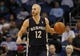Feb 12, 2014; Orlando, FL, USA; Memphis Grizzlies shooting guard Nick Calathes (12) drives to the basket against the Orlando Magic during the first quarter at Amway Center. Mandatory Credit: Kim Klement-USA TODAY Sports