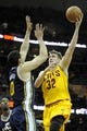 Feb 28, 2014; Cleveland, OH, USA; Cleveland Cavaliers center Spencer Hawes (32) shoots over Utah Jazz center Enes Kanter (0) during the second quarter at Quicken Loans Arena. Mandatory Credit: Ken Blaze-USA TODAY Sports