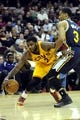 Feb 28, 2014; Cleveland, OH, USA; Cleveland Cavaliers point guard Kyrie Irving (2) drives around Utah Jazz point guard Trey Burke (3) during the second quarter at Quicken Loans Arena. Mandatory Credit: Ken Blaze-USA TODAY Sports