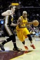 Feb 28, 2014; Cleveland, OH, USA; Cleveland Cavaliers point guard Jarrett Jack (1) drives on Utah Jazz shooting guard Gordon Hayward (20) during the first quarter  at Quicken Loans Arena. The Cavaliers beat the Jazz 99-79.  Mandatory Credit: Ken Blaze-USA TODAY Sports