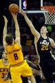 Feb 28, 2014; Cleveland, OH, USA; Cleveland Cavaliers shooting guard Matthew Dellavedova (8) shoots as Utah Jazz shooting guard Gordon Hayward (20) defends during the fourth quarter at Quicken Loans Arena. The Cavaliers beat the Jazz 99-79.  Mandatory Credit: Ken Blaze-USA TODAY Sports