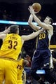 Feb 28, 2014; Cleveland, OH, USA; Utah Jazz shooting guard Gordon Hayward (20) goes up for a shot as Cleveland Cavaliers center Spencer Hawes (32) defends during the third quarter at Quicken Loans Arena. The Cavaliers beat the Jazz 99-79.  Mandatory Credit: Ken Blaze-USA TODAY Sports