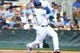 Mar 2, 2014; Phoenix, AZ, USA; Los Angeles Dodgers right fielder Yasiel Puig (66) hits the ball in the third inning against the San Diego Padres at Camelback Ranch. Mandatory Credit: Joe Camporeale-USA TODAY Sports